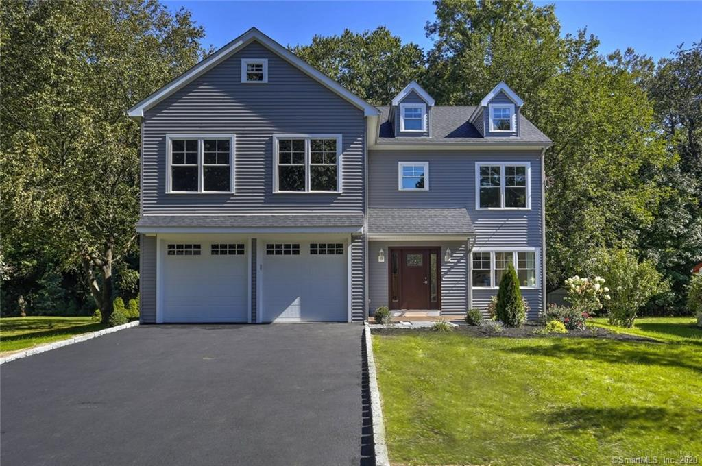 NEW CONSTRUCTION HOME IN FAIRFIELD!!!  232 Harvester is perfectly situated on a quiet tree-lined block on .25 acres and nestled in the coveted Lake Mohegan neighborhood. Lake Mohegan is home to a fresh water lake and a sandy and sunny beach, and a 4.0 kilometer loop trail that offers a number of activity options.  Move right in and be ready to enjoy all the Town of Fairfield amenities that makes this town the place to be!  Designed with today's buyers in mind, this Custom-built Colonial-style home comes complete with 4Bedrooms, 2.5Bathrooms, Central Air, Gas Heat, 2-Car Garage, Mudroom and FULL Basement (can be finished at added cost), —plus FLEX space on upper level that can be converted to a 5th bedroom, office/home school, play area or tv/entertainment space!  The Grand Master Suite is spacious and bright featuring a Walk-in Closet and exquisitely finished Master Bathroom. Need even more Storage space? There is a pull down attic for extra storage!   Main level Living space has a sunny open concept floor plan, and showcases architectural details, crown moldings, and hardwood floors throughout. Spacious Kitchen equipped with Granite counters, Kitchen Island and SS appliances and leads to a private deck to BBQ or just sit back and relax.  Open Living Room with Gas fireplace and a separate Dining Room with a built-in Bar make 232 Harvester an entertainer's dream!