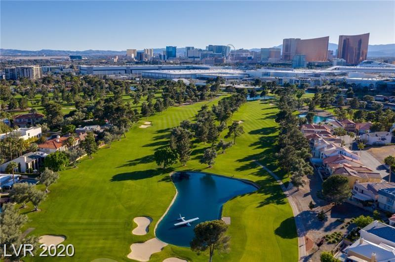 Beautiful Condo. Golf Course Frontage. Beautiful Golf Course view. End Unit, Move in ready, 2 Balcony's. All Appliances Includes, Stainless Steel Refrigerator. Washer Dryer, Granite Countertops, Brand New Carpet. all wood blinds stay! Freeway Access...only 5-10 Minute To Las Vegas Strip! Near Shopping, Parks ,Hospitals & More. MUST SEE.....  WON'T LAST.....