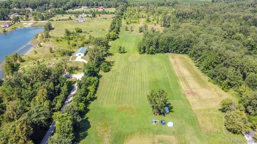The property is located behind 9277 Willis Rd. With a 66 ft easement on the left of the home to the back of the property. Up to 5 splits are available. The survey is available. The land is buildable but has not had a perk test yet. Stay tuned for more photos!