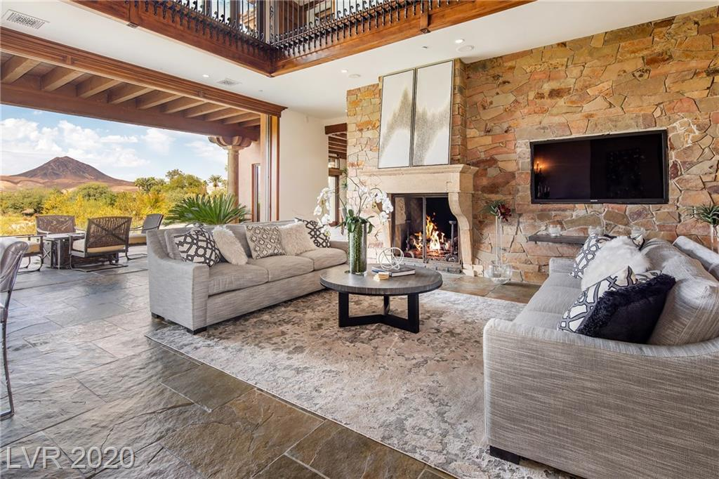 """This luxurious Villa has beautiful mountain, lake and golf course views. It also has a pedigree that speaks for itself. Featured in Las Vegas Home & Design Magazine as an """"estate that truly merges indoor and outdoor living""""; and, selected to showcase Lake Las Vegas in the filming of the Andrea Bocelli performance. It sits on the 4th hole of the private SouthShore Country Club, a Jack Nicklaus Signature Course, and is just minutes away from a second Jack Nicklaus public course at Reflection Bay. Features include retractable glass doors, a large wet bar in the living area, ~1,600 bottle Wine Cellar, elevator, vaulted wood ceilings, slate floors, imported mantels, a double boosted clay tile roof, Viking appliances, antique fixtures, outdoor kitchen, infinity edge pool, master bath sauna and much more. Close to water and outdoor activities, restaurants, hospitals, shopping and about 30mins from the strip."""