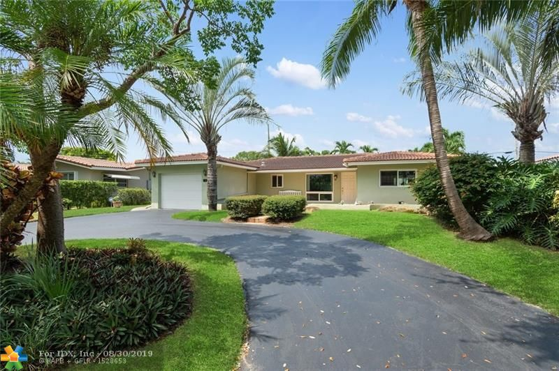 Lovely 3 bedroom 2 bath home with heated pool and garage parking in the Knoll Ridge Section of Fort Lauderdale.  Open Kitchen with natural gas stove, master bedroom with ensuite.  Impact windows and doors throughout and full house natural gas generator. Split guest bedrooms with access to pool area.