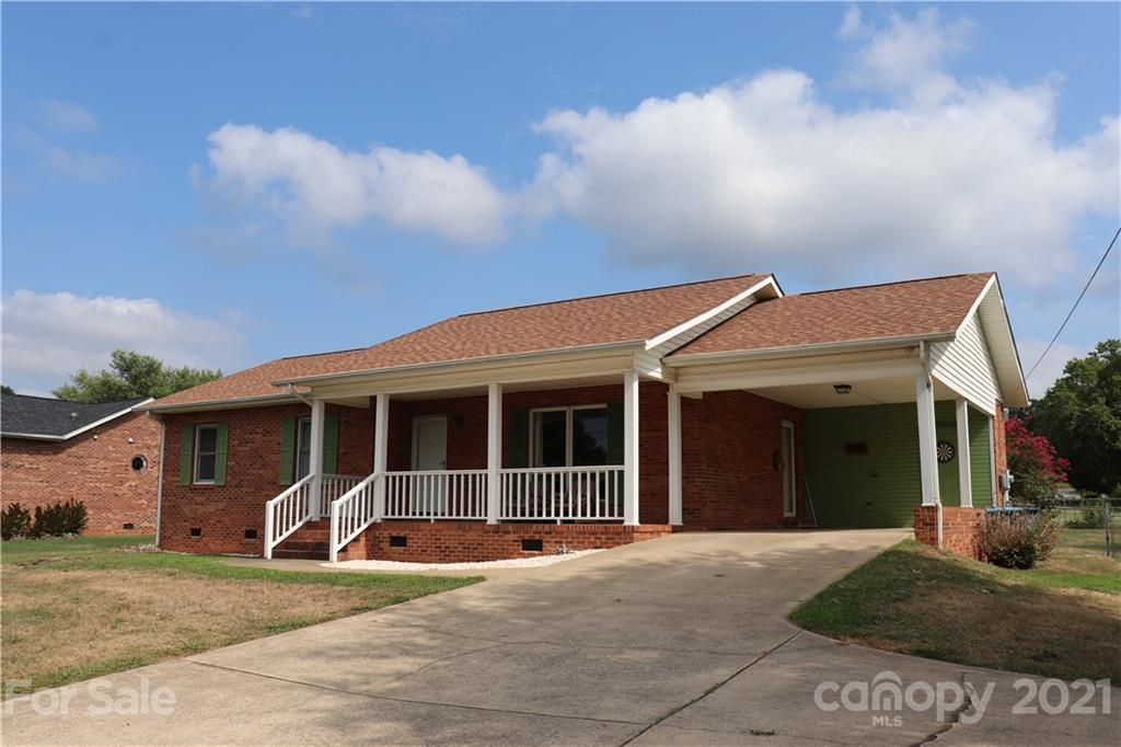 """Welcome Home... to this custom built spacious 2 bedroom, 1 bath brick home in NW Hickory conveniently located with easy access to Hwy 321! Relax on the covered front porch, or in your very own screened-in porch! The kitchen features lots of cabinet and counter space, and includes electric range and refrigerator that convey. The walk-in laundry room is located off the kitchen with enough space for storage and a pantry, and the washer and dryer stay. The bedroom closets are the length of an entire wall with double bi-fold doors. Spacious bathroom with dual sink vanity, tub/shower combination and linen closet. The home features 36"""" wide doorways and extra electrical outlets. 5X13 storage room off the carport, plus a storage building inside the fenced backyard. HVAC replaced in 2017 per the seller. Schedule a showing today!!!"""