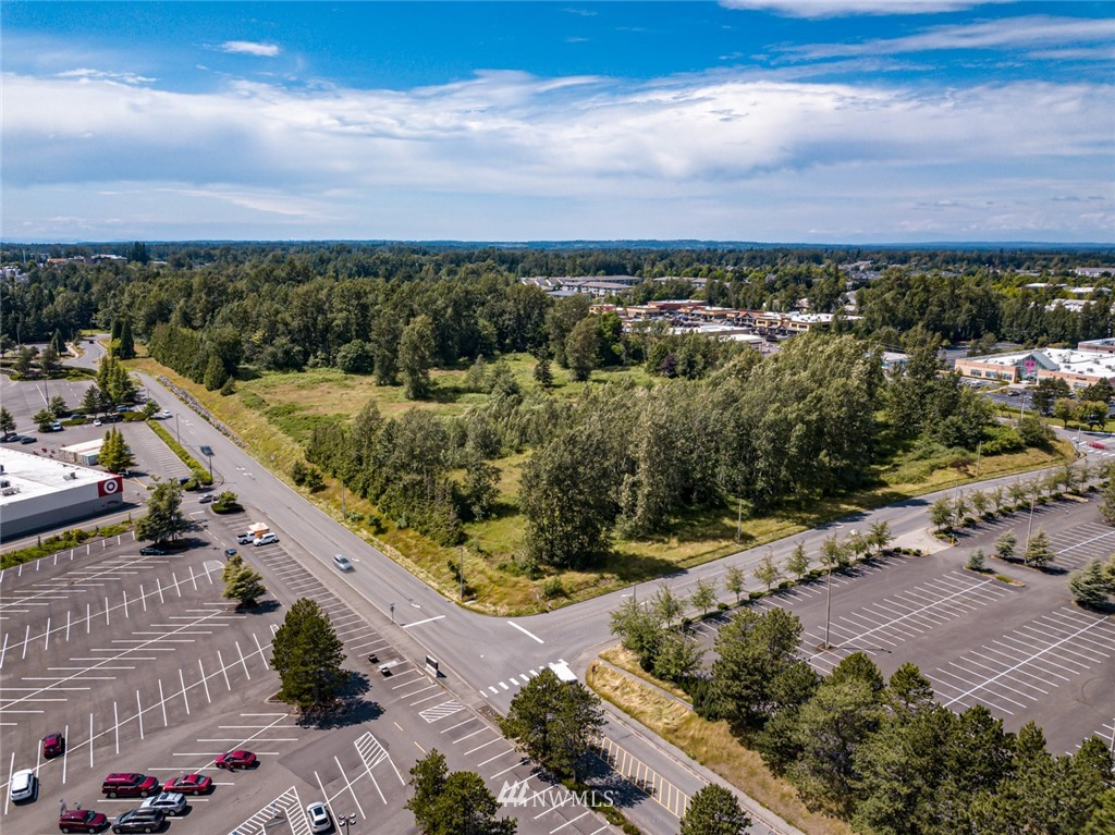Approximately 13.68 acres with frontage on West Bakerview Road. Adjacent to multiple housing and retail developments in a growing area of Bellingham. Close proximity to Fred Meyer, Costco, Bellis Fair Mall and access to I-5Commercial zoning allows for a multi- use plan including apartments but must be approved by the city of Bellingham.