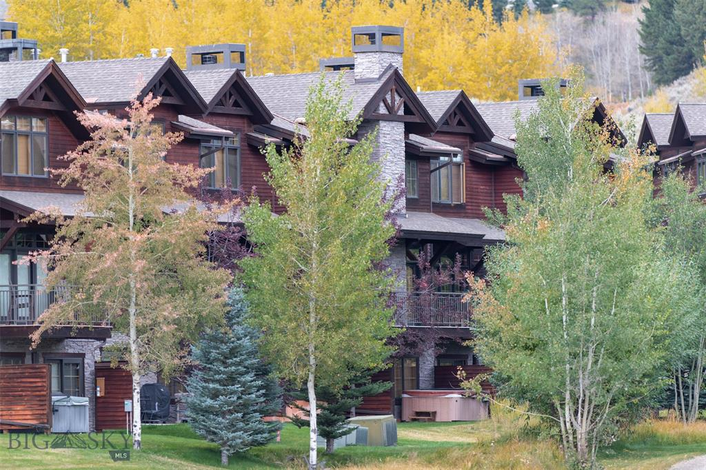 Rare opportunity to own the largest floor plan in the much sought after Spanish Peaks Club Condos in Big Sky's Meadow Village. Comfortable floor plan, spacious great room with a wood-burning fireplace, coffered ceiling and deck, a lower level hot/tub patio that backs up to a babbling brook, and carefully selected finishes throughout. A lower level bonus room offers the flexibility of sleeping extra guests. Offered furnished. The complex has a clubhouse with a pool and exercise equipment and is available to both owners and guests.SPC has easy access to the amenities of Big Sky. If you are looking for location, access to trails, golf, shopping and dining in the Town Center, and close proximity to skiing, this a great place to look.