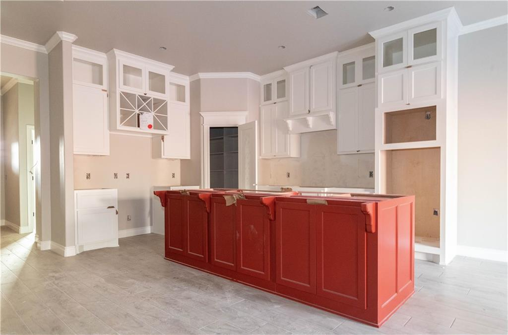 This Shiloh Half Bath has the perfect kitchen for you! Built in stainless steel appliances, cabinets to the ceiling, large island, and 3CM quartz countertops are just a few pieces that give this kitchen great characteristic.  Home has 4 bedrooms, 2 and a half bathrooms, and a 3 car garage with a storm shelter installed. Home is 2,295 Sq Ft of total living space, which includes 2,000 Sq Ft of indoor living space and 295 Sq Ft of outdoor living space.  Wood look tile covers the main flooring, leaving a clean and open feeling. Living area offers a gas fireplace with stack stone and gorgeous detailing to the ceiling, large windows, and barn door that separates the spare rooms! Master suite is secluded and offers his and hers closets and vanities, large master shower, and a box ceiling with incandescent lighting. Other amenities include Smart Home technology,  Rinnai Tankless water heater, whole home air purification system, R-44 insulation and Solarboards.