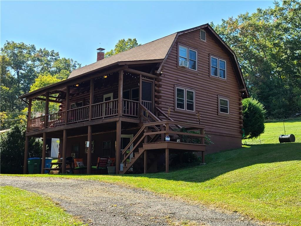 VIDEO AVAILABLE. Equestrian retreat? Mini Farm? Second Home delight? Artist's studio?  Airbnb? VRBO? So many possibilities with this log home on 3.38 acres of gently sloping pasture, with incredible long range layered views from the top. Prime location in the Cane Creek Valley, Asheville's horse country, just 20 minutes to downtown Asheville. New kitchen with a breakfast bar and stainless appliances in the log home. Lower level apartment and upper bedrooms, as well as the whole cabin may be used as AirBnB which has been lucrative for the current owner. Lovely covered porch to enjoy your retreat. Bring your horses with the around 1200 SF barn with two stalls. Vines and fruit bushes on site. Close to all amenities south of Asheville NC, and to the airport and Hendersonville.  8k+ per month in income per seller thru airbnb.No showings in Jan- Please Attend Open House on Sun Jan 10th 1-3pm