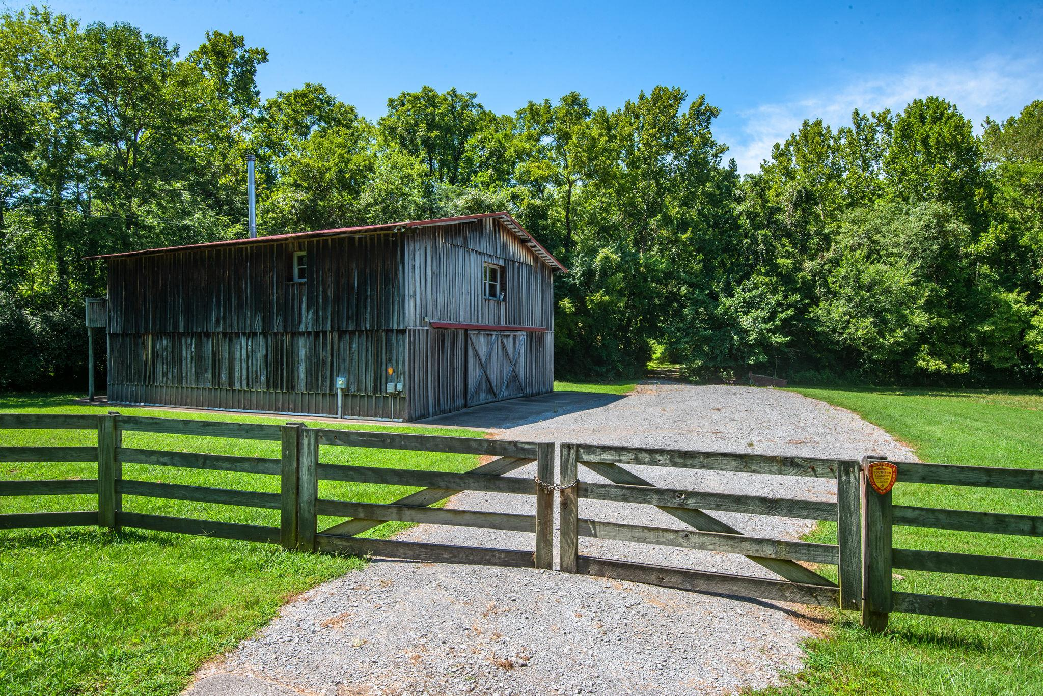 Gorgeous 36 acre estate in prime location! Build your own private compound among the wooded & rolling hills with room for all the animals of your dreams.  Property includes 4,000 sq ft barn w/ over 2700 sq ft of finished living space w/ full kitchen, laundry room and 2 full baths. Perfect for the weekend retreat & only minutes to everywhere! Amazing opportunity for future luxury residential development with 1252  of road frontage. Current R2 zoning, utilities available, sewer abuts the property