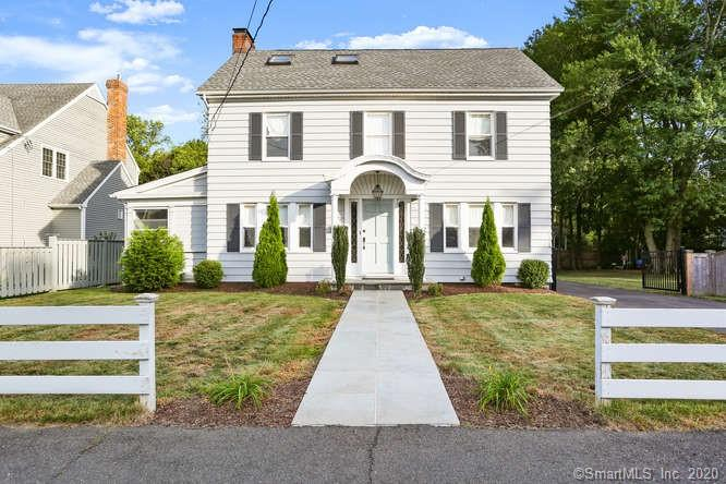 This classic Colonial is the perfect blend of vintage and contemporary. Completely remodeled in 2017 this home features a desirable open floorplan, original hardwood floors & much more. The main level boasts a spacious living room equipped with a cozy fireplace, powder room, and rec/play room. The kitchen is a chef's dream with high-end finishes including stainless steel appliances, marble counters, custom cabinets, tile backsplash & center island. The 2nd level is home to 3 bedrooms including the master suite w/ unique barn door closet. The 3rd floor features vaulted ceilings, skylights, & bonus space to be used as a guest room, home office, den or whatever you would like! Situated on a spacious corner lot this home has a large level, fully fenced-in backyard - perfect spot for pets & families! Numerous updates completed in 2017 including tankless water heater, central A/C, high efficiency furnace & roof! Great location - move-in ready!