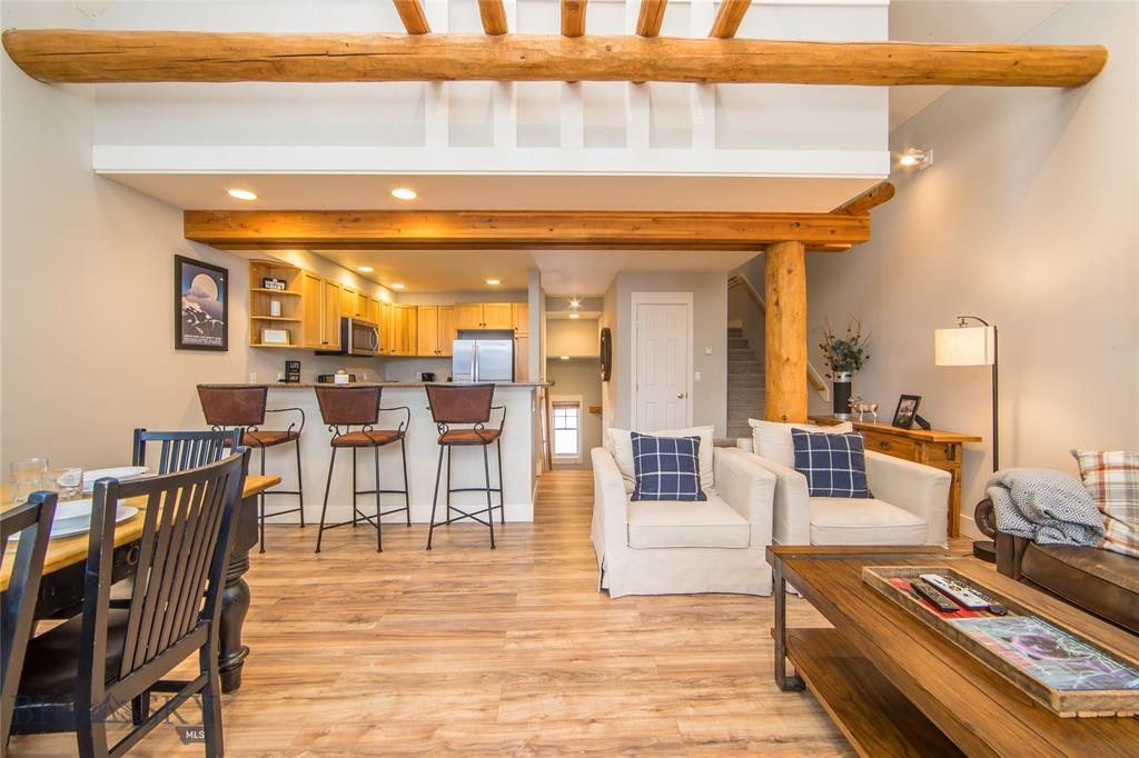 """In the Saddle Ridge Community of Moonlight Basin, this ski-in/ski-out townhome is steps away from Moonlight Lodge providing direct access to the Iron Horse ski lift with breathtaking Spanish Peak Mountain views as you relax in your private hot tub. Click on your skis and jump on the Iron Horse or Pony Express ski lift or start your day hiking or biking on the Moonlight Basin summer trail system right from the front door. Tastefully decorated, this 3-bedroom, 2.5 bath townhome has many upgrades which include wood flooring, granite countertops in the kitchen and bathrooms, stainless steel appliances and new carpet throughout. Offered """"turn-key"""" fully furnished, this townhome is the perfect choice for a luxury rental or family retreat for all seasons!"""