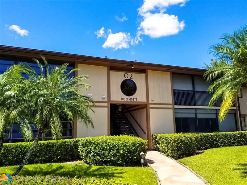 Kings Point in Tamarac is a homeowner's dream come true. This luxurious, active senior community is complete with 13 beautifully landscaped neighborhoods. There are 4,869 units of spacious Condominiums, Villas and Coach Homes with perfectly laid out floor plans, situated on tranquil lake views. Each community has their own private recreation area. This unit is located in the Clairmont neighborhood.  The unit is open and spacious and ready to move in.  The Azalia model features 1,163 square feet of living space under air condition and has a patio that is 111 square feet and is tiled screened and has rolladen hurricane shutters for protection.  The unit has access to a chair lift right outside the door.  Inside has 2 bedrooms and an open den that can convert to a third bedroom.