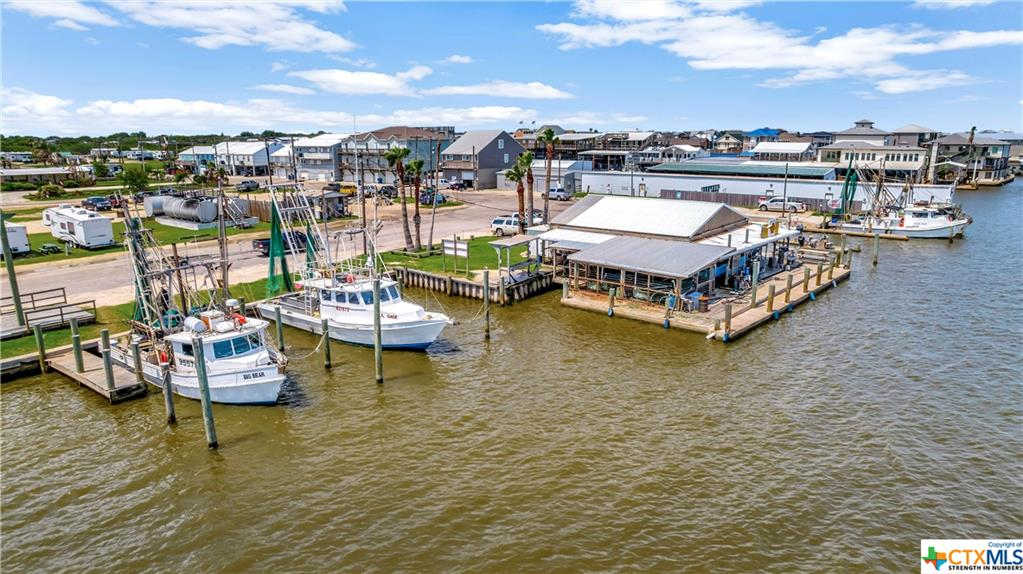 Don't miss out on this great development opportunity on the Texas Gulf Coast!  This 3.7 acres is prime location with approximately 600' of Intercoastal Water Way frontage in Port O'Connor, TX.  Currently known as The Fishing Center, it provides access to on water fuel, ice, bait and last minute items.  Property features boat ramps, trailer parking, RV camp sites and boat slip rentals.  Previously platted for an 19 lot subdivision, this property has endless possibilities.  Port O'Connor is located within a few hours of most major cities and is known for it's quaint small town vibes.