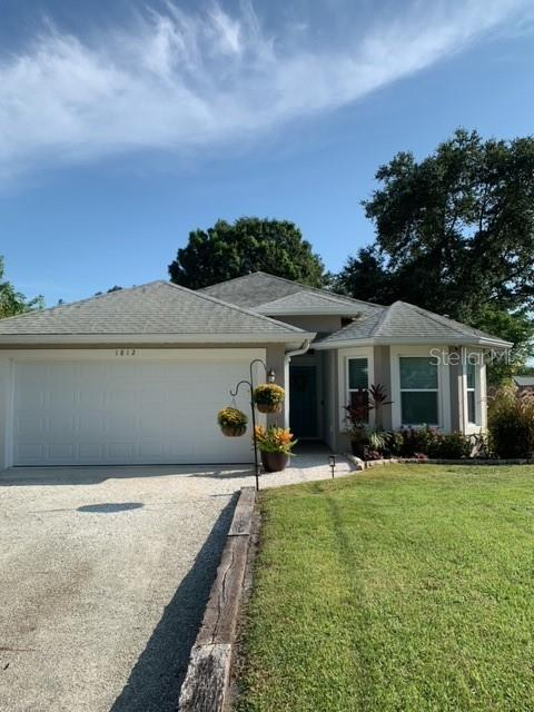 """WOW...put this newer home at the top of your list!   With its vaulted ceilings, this 2014 3BR/3BA built home is sure to please.  Kitchen features include: granite counters, 42' Shaker-style cabinets, stainless steel appliances, roomy pantry, and is open to the living/dining area.   12"""" x 24"""" Porcelain tile throughout living areas, and laminate in the bedrooms (NO CARPET).  Other notable extras include: """"bullnose"""" rounded corners, 5-1/4"""" baseboards, recessed lighting, central vac and pocket doors.   Lots of closet space in this open, split plan.   Fantastic Master Bedroom with a newly remodeled bathroom.   Energy Star Rated to save you $$ on electric bills with the 15 SEER heat pump and PGT Vinyl IMPACT RATED HURRICANE WINDOWS.   Plantation Shutters frame the lovely garden view which can also be enjoyed from the screened, paver lanai.  3 sets of pocket sliding doors allow for enjoyment of complete indoor/outdoor living.  The fully fenced yard (8 ft) is a Cinderella's delight with the daily visits from a variety of birds, bunnies, frogs, etc...   The newly, lush landscape is a beautiful backdrop...could easily spend hours enjoying.  The garage is also air conditioned for added comfort.  No HOA, No Flood Insurance, and No CDD!   This home is impeccably kept and a real Show Stopper!!!  Hurry and take a look, this one won't last long!!!"""