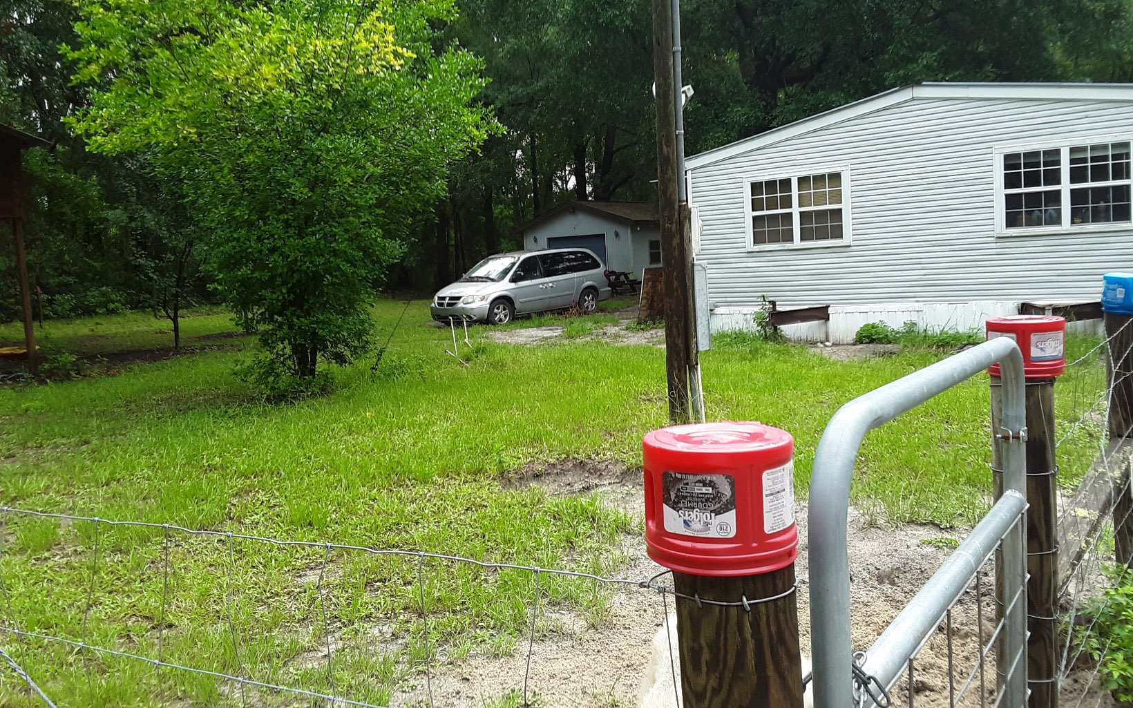 2 Wells 2 Septic Tanks, High Dry Land, Beautiful Trees on Lot and Good Roads, Great Rental Potential, Home has Porch on Front and Carport on Back. Can Purchase The Lot that has well, septic and power pole for $26,900