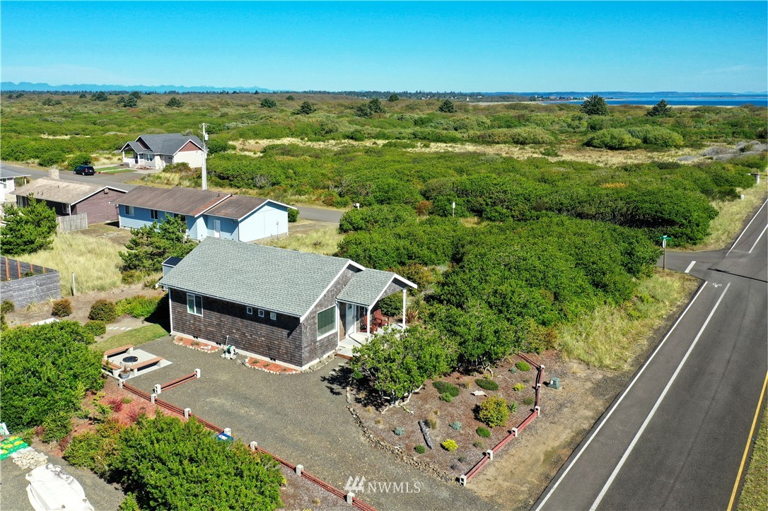 Beautiful like new seaside cottage with professional landscaping installed in an awesome location close to the beach access. Enjoy the sound of the ocean waves, mild climate, and fun things to do. This perfect escape is constructed with excellent materials and quality craftsmanship. This home was built in 2018 and you can take comfort in knowing that you will have years of carefree ownership because the home was constructed to last. Easy living at the beach has never be more fun and easy