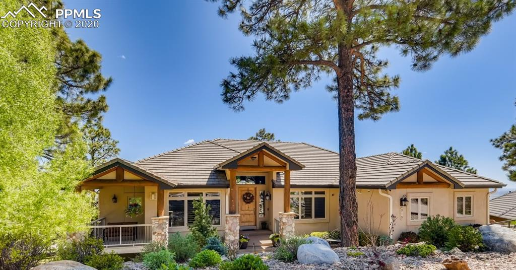 If you are looking for a custom Colorado mountain home tucked into the foothills, look no further. This magnificent home in Stonecliff has everything you are looking for-luxurious finishes, rustic touches and views that stretch forever. Hickory wood floors are met with tongue-in-groove wood ceiling details, authentic stone fireplaces, log pillars, custom alder wood doors and shutters. The home is laid out perfectly for entertaining your friends and family with large, open spaces on the main level