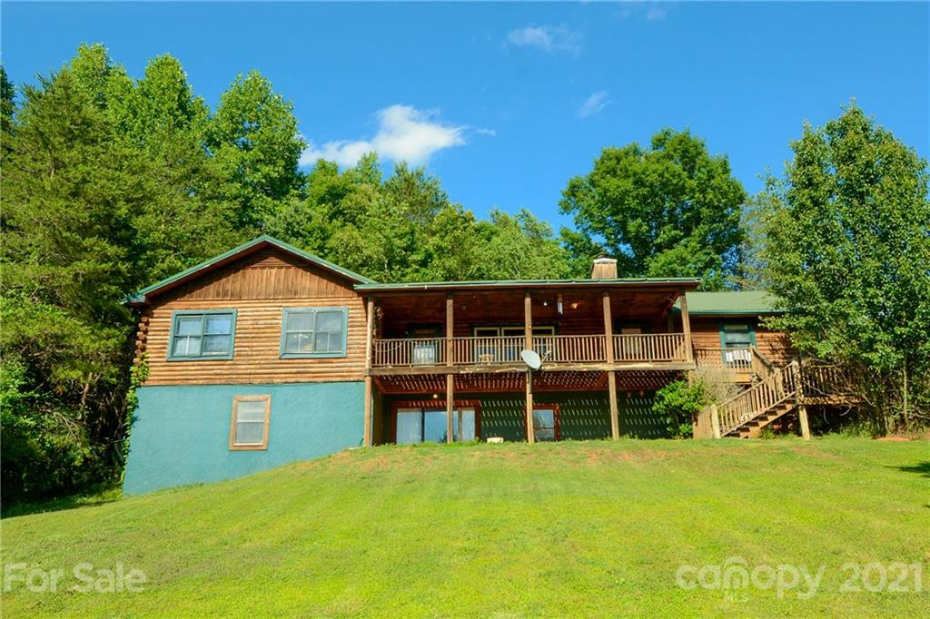 Come Check out this wonderful Log home sitting on top of 5.8 unrestricted acres. This is a must see home for anyone looking in the area. It features 3 main level bedrooms, a wood burning fireplace, incredible mountain views and even a Natural gas ALL HOME GENERATOR! Not to mention the attached garage, Large Barn and separate workshop with concrete floors.  The full finished basement offers extra living space, 3 office rooms with closets and even a full bathroom.   Located Just 2.7 miles down the road from the Tryon International Equestrian Center!