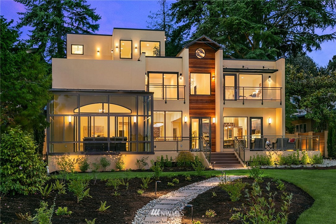 Spectacular west-facing waterfront new construction! Gated 5BR, 8BA Modern home at the end of a lane in tranquil Holmes Pt. 6,648 SF w/open floorplan incls chef's kitchen open to large great room & huge glass sunroom for year-round indoor/outdoor living! 12,672 SF level lot w/73' of prime frontage. 120' newer dock w/7+ feet of depth – room for multiple watercraft & guests! En-suite BRs, elevator, immense flex spaces & 3 car garage. Large entertaining decks on two levels & level lawn to the water. A+ location near 600+ acres of protected forests & trails. Rare chance to avoid 2-4 years of design, permits & build time for a waterfront home of this magnitude. Enjoy maritime performances & amazing waterfront vistas from this stunning new home!