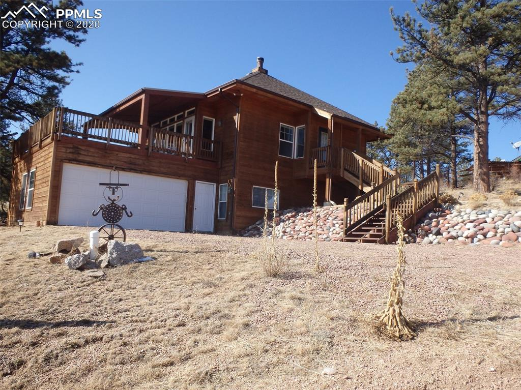 Awesome home in sought after fishing community. 2 master suites--one on the main & one on lower level. Huge rooms and closets abound. Cozy great room style with wood burning fireplace, dining area that looks out onto spacious deck with fantastic views of Pikes Peak, lakes and streams. Tons of cabinet space and counters in the wall hugging kitchen--no wasted space. Master suite on the main level boasts a walk-in wall closet and adjacent bath with large shower and vanity. Lower level has another master suite with walk-out.