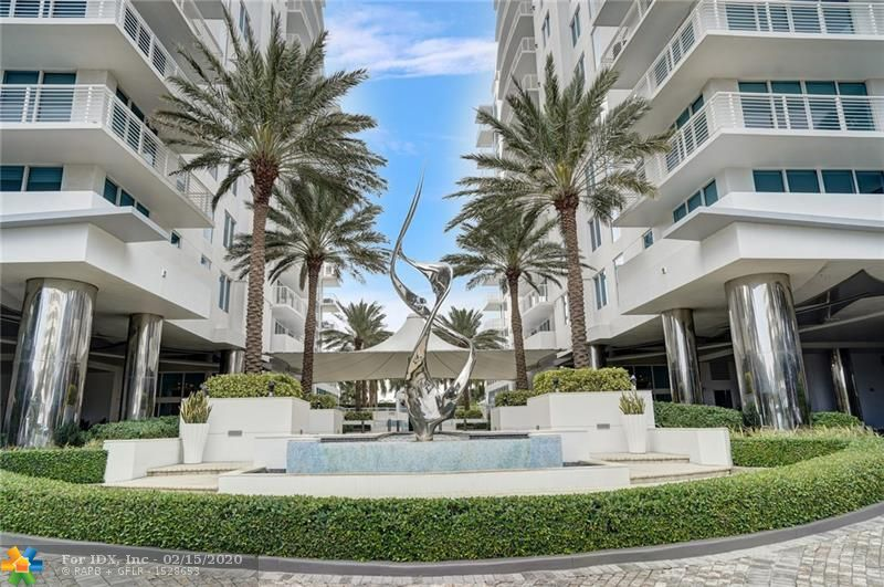 Ocean views from this bright 3 bedroom 3 bath corner unit in the fabulous Sapphire community. Spacious floor plan with soaring floor to ceiling windows in the living and dining room. Separate den, custom bar and travertine floors throughout. SS appliances, granite counters, large master bedroom and bath separate from other guest bedrooms. Custom lighting, draperies and shades finish out the space. 2 blocks to the beach. Garage parking or use 24-hour concierge or valet for your convenience. 5-star building featuring a 25-meter lap pool, cabanas, hot tub, steam rooms, saunas and massage rooms. Beautiful club room with catering kitchen, meeting room, business center and coffee bar. Monthly HOA includes a membership to the Marriott at Harbor Beach club for the ultimate beach front experience.