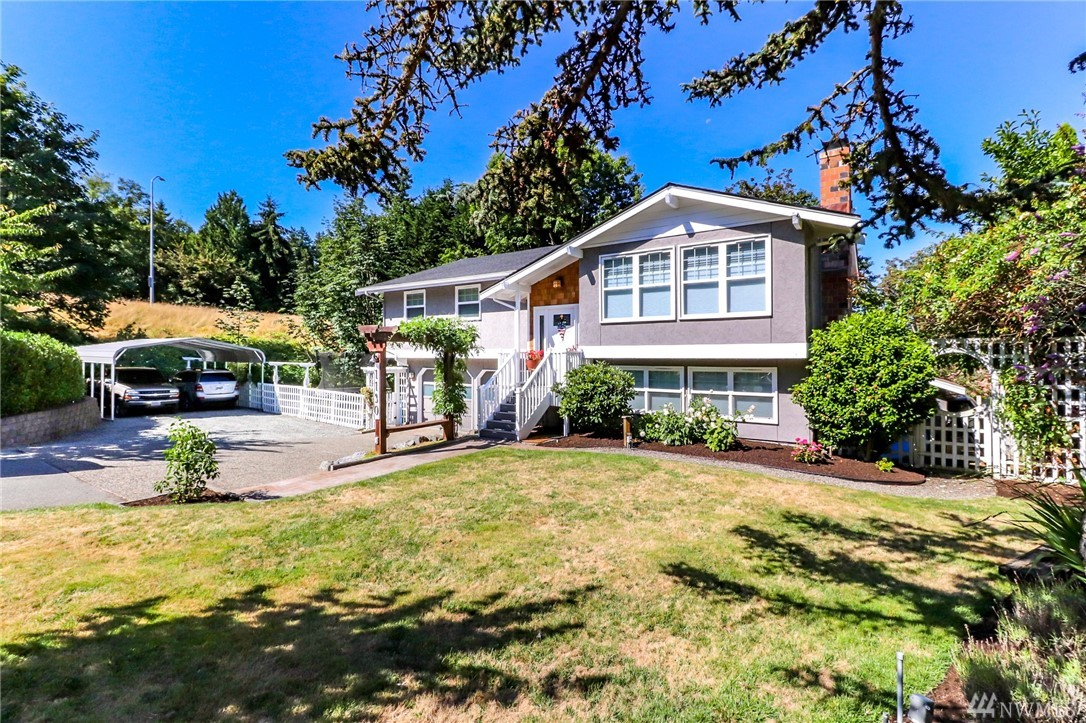 Entertainer's dream in the Edmonds Bowl! Walk-able to many restaurants & parks! Take in Puget Sound views & watch Ferries pass by from your spacious deck.  Fully fenced backyard w/ mature landscaping gives it a park-like feel. Large Kitchen beautifully remodeled has walk-in pantry. Master Suite boasts walk-in shower & sliders to deck. Lower level bonus room complete w/ custom wet bar/fridge, + Guest Suite w/ Murphy Bed. 2 car garage + workout area/shop space & large 2 car carport — plus RV!