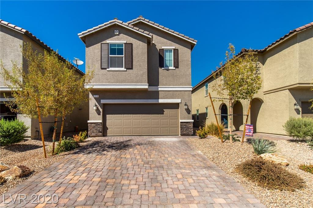 Contemporary KB Home on a premium lot in the gated Tanglewood community of Tule Springs. Desirable neighborhood offers an exciting lifestyle with trails, parks, recreation, and convenience. Inviting curb appeal is enhanced with pavers, stone accents, and covered front entry. Like new home is complete and ready! Open concept living highlighted by perfectly placed windows allowing natural light to pour in. Kitchen opens to family room and is complete with granite, quality cabinetry, roll outs, high-end appliances, and extra electrical including USB outlets. Family room slider leads to outdoor living. Restful master suite has custom paint, ceiling fan, walk-in closet, and a spa inspired bathroom. Relaxing yard with paver stone patio, synthetic lawn, and curbing. Convenience items include extra insulation, insulated garage ceiling, radiant barrier, wrapped pipes, photo cell, tankless water heater, programmable thermostats, and zoned hvac.