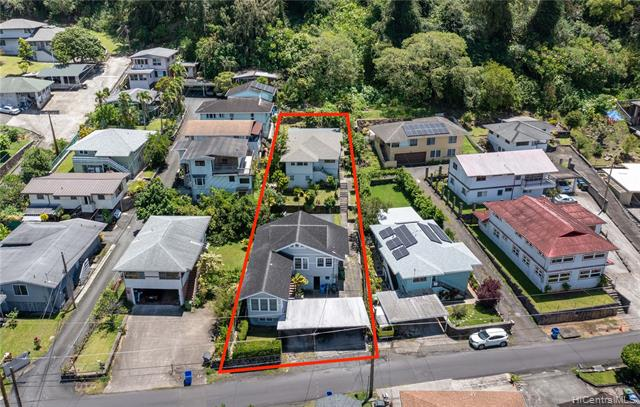 Looking for a lucrative investment opportunity with 6 units? Then look no further! This large lot comes with 2 seperate houses fully tenant occupied. For investors looking to optimize cash flow in Hawaii, where can you find a property with a Cap Rate over 4%? Located in the quiet and tranquil valley of Nu'uanu, you're a few minutes from the Pali for easy access into town or out to Kailua making this a highly desired rental area. FRONT HOUSE: 3 seperate units. Upstairs is (1) a 2bd/1.5ba and (2) a studio, and (3) a 2bd/1ba downstairs. BACK HOUSE: 3 seperate units. Upstairs has (1) a 2 bd/1ba and (2) a studio, then downstairs is (3) a studio. Each house has its own water and electric meters. A well maintained yard seperates the houses, and a paved walkway with steps to traverse the property. The carport and driveway boast parking for 6.  So come check out this great investment property to add to your cash flowing portfolio. TMK info differs from actual.