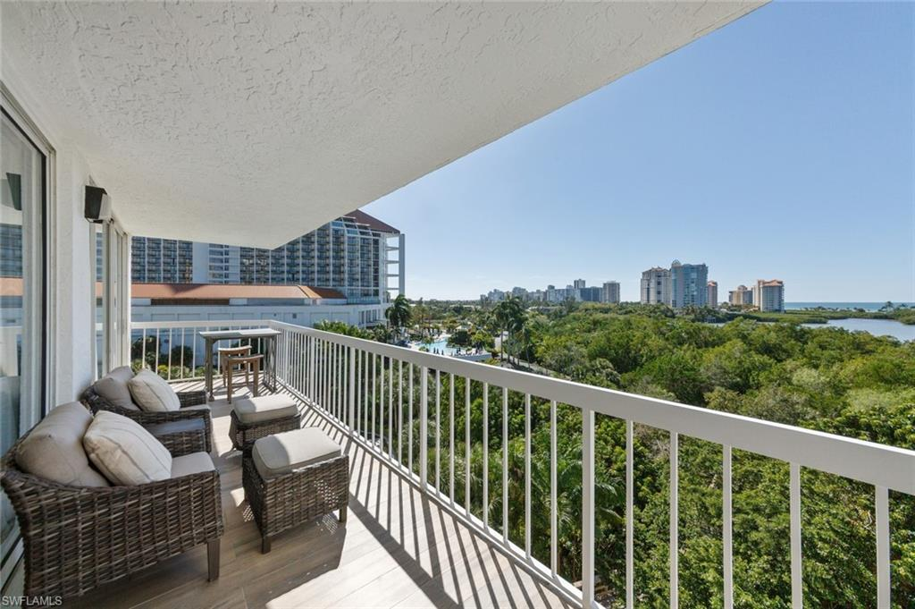 Dramatic Wide Open Sweeping Panoramic Southwest Views of Clam Pass & Gulf of Mexico From This Corner End Unit Of St. Tropez In Pelican Bay.  Experience Naples Stunning Sunsets & See The Wildlife of The Preserve/Mangroves From This 5th Floor Open Air Balcony.  St. Tropez Building Is Uniquely Located On The Most Southern Side Of Pelican Bay & Within Walking Distance To Waterside Shops & Artis Philharmonic Center.  Access To Beaches Is By Private Tram Located Just Steps From Residence. Beach Services Includes Use of Chair & Umbrella. Canoeing, Kayaking & Sail Boating Also Available.  There Are 2 Private Beachfront Bar/Restaurants plus Beach Pavilion & Wellness Activities, 3 Miles Of Trail/Nature Paths, Tennis Center, Pro Shop, Pickleball, Professional Fitness Center With Spa Facilities.  Residence Has Been Renovated With Kitchen Opened To Living Area. Custom White Kitchen Cabinetry, Quartz Island & Countertops, Wood-Like Tile Throughout, New Bathrooms & Light Fixtures & Is Being Offered Turn-Key Furnished. 1 Assigned Covered Parking Space & Storage Unit Included. St. Tropez has been recently remodeled & painted. Building has Lap Pool/Whirlpool Spa/Tennis & Fitness Room.