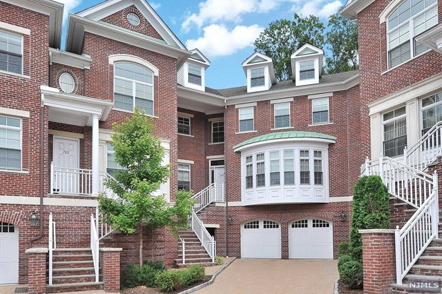 NO SUPERLATIVES ARE NEEDED TO DESCRIBE THIS ONE OF ONLY TWO DEVON MODEL TOWNHOUSES AT THE HEIGHTS. FEATURING 5136 SQ FT OF LIVABLE SPACE (APPROX. 30% LARGER THAN MOST OTHER UNITS) & LOCATED ON THE HIGHER CORNER OF THE EXTERIOR LOOP. THIS UNIT WAS DESIGNED BY THE DEVELOPER TO BE THE MOST LUXURIOUS UNIT, HAS BEEN FURTHER UPGRADED & IMPROVED BY THE CURRENT & FIRST OWNER IN EVERY ASPECT. THE MASTER SUITE IS APPROX. 800 SQ FT WITH HUGE WALK-IN CLOSET & CEILING HIGH CLOSETS & AN ISLAND WITH A MARBLE TOP). 3 BEDROOM SUITES, AN ELEVATOR TO 3 LEVELS, CRESTON AUDIOVISUAL SYSTEM WITH CABLE & INTERNET, WHOLE HOUSE 20KW GENERATOR, WHOLE HOUSE WATER SOFTENER SYSTEM, WINE CELLAR, GYM & A HOME THEATER. UPGRADED CEILING HIGH CABINETS IN KITCHEN, TWO FARMER'S COPPER MADE SINKS, INSTANT HOT WATER SYSTEM, DESIGN TILES IN KITCHEN, STONE BACKSPLASHES AND THREE FIREPLACES (IN LIVING & FAMILY ROOMS & MASTER BEDROOM). EXTRA LARGE DRIVEWAY FITS FOURS CARS. NO OTHER TOWNHOUSE LIKE IT TO BE FOUND IN TENAFly
