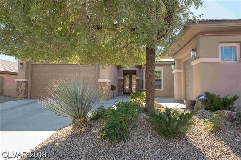 Nestled in guard gated Club Aliante. This is a 5 star energy home. Beautifully landscaped. Tile and wood flooring. 5 inch wood half tilt shutters. Surround sound speakers. GE Monogram appliances, granite counters with granite back splash. This home is finished and ready for your touch.