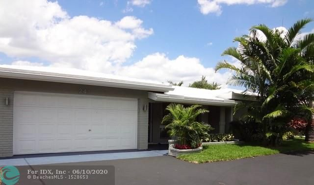 BEAUTIFUL WATERFRONT OASIS w/NEW ROOF SCHEDULED IN JUNE, 2020!! Lovely updated 3 bed/2 bath 2,176 s.f. home is on a quiet, extra wide canal w/ocean access - just minutes to beach, waterfront dining & shopping. UPDATES include: 35' dock w/new lighting, new sprinkler system, tankless water heater, A/C, exterior lights, fresh paint, remodeled 26' x 13' Florida room w/built-ins. IMPACT GLASS, oversized heated POOL & JACUZZI, 23' x 14' covered patio, lush landscaping and more!