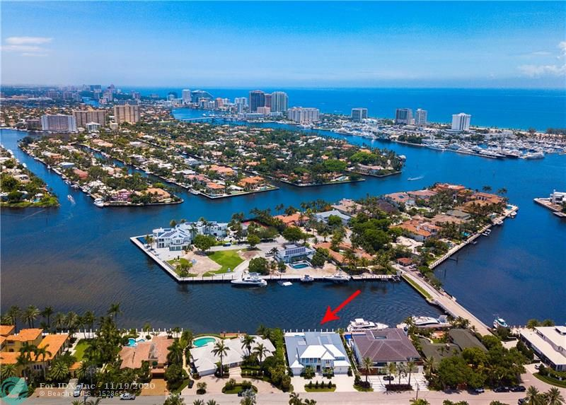 Brand new Coastal Modern direct intracoastal residence offers the most amazing open views from one of Harbor Beach's finest & most valuable isles! Timeless design offers a highly welcoming appeal! The elegant island ambiance & soft blue-grey interiors create a beautiful living environment flows seamlessly from indoor to outdoor entertaining areas. Open great room features fireplace, custom stone/hardwood flooring, elegant formal dining room & crisp white kitchen open to breakfast area. All open to impressively large poolside loggia, outdoor living room fireplace & Summer Kitchen. Expansive downstairs Master Suite, library - second level VIP Guest Suite & two additional bedroom suites, 5th bedroom currently used as Den. Architect Stofft/Builder Sarkela guarantees a high quality offering.
