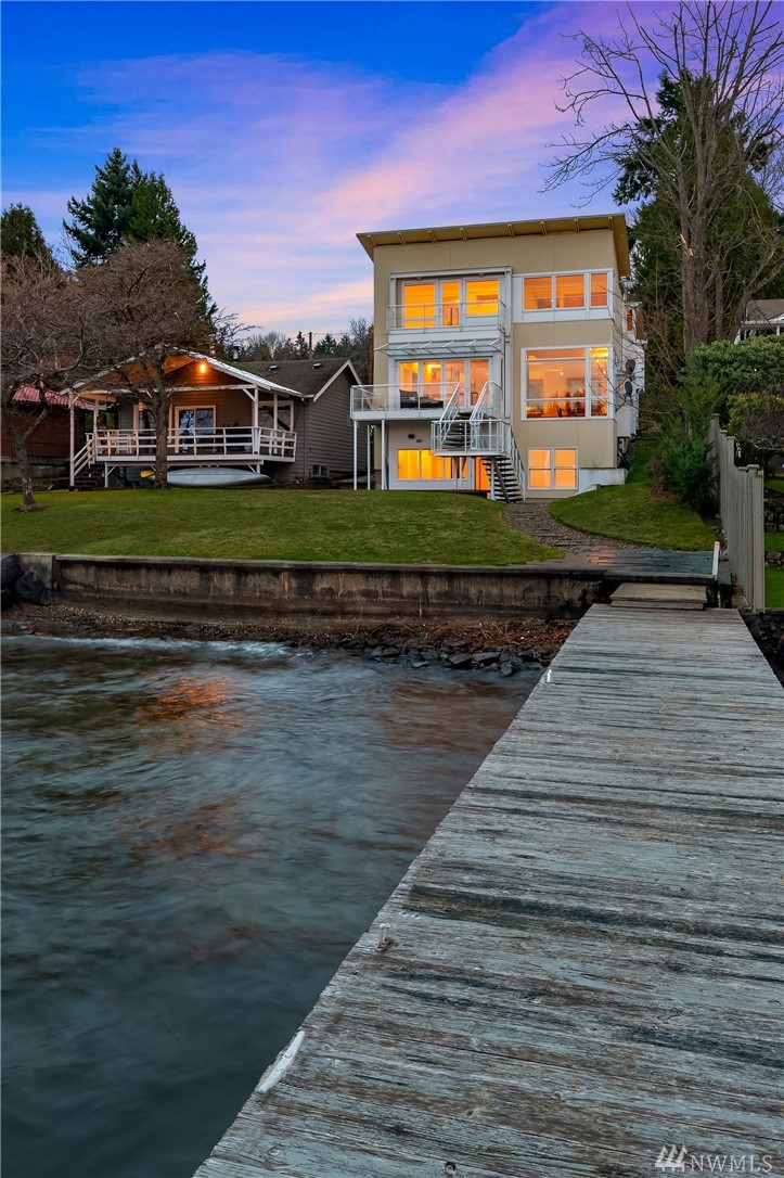 Welcome to the Modern Masterpiece at Pleasure Point Lane. Standing at the waters edge of 45 Ft. of Lake Washington's waterfront. This custom built 4,000 Sq.Ft. offering wont disappoint w/floor to ceiling windows, clean modern lines, floating staircase & built in's throughout. Fabulous chef's kitchen for the epicurean. Entertainment sized spaces for those special gatherings or just relaxing & taking in the views from the many balcony's. Bellevue schools, easy commute. Private, peaceful, perfect!