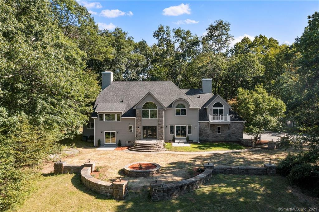 """Never before available...Custom Built: This magnificent home sits atop over 4 private wooded acres, while still managing to be in an established neighborhood cul-de-sac. A stunning 20 foot plus foyer greets you upon entrance, with and abundance of natural light, gleaming hardwood floors, new lighting, new paint... it still has that """"new house smell"""". An open-concept first floor with oversized great room, large dining room and first floor study are just the start. The kitchen has been completely redesigned - White Shaker Cabinets, Black Hardware, White Stone & Stainless Steel Appliances. There is a generous first floor laundry room, an oversized drop-zone/mudroom, flex space and a 3 car garage. Three separate patios are perfect for playing, dining and relaxing - taking in the breathtaking Hartford skyline views. Upstairs you will find 3 guest rooms, with 2 being en-suites. New Bathrooms boast white subway tile, new vanities & designer colors. The primary suite has room for both the owner's bedroom and gym equipment/office space/nursery. The bathroom has a large glass walk in shower, double vanity, soaking tub and heated tile floor. The lower level is partially finished allowing for more storage, recreation or flex space. This sale includes both 25 & 37 West Ledge, encompassing a total of 4.29 acres. Don't Miss the Video Tour: https://vimeo.com/610059490 Showings to Begin Wednesday, September 22, 2022.  Owner is a Licensed Real Estate Agent. Don't Miss the Video Tour: https://vimeo.com/610059490 Showings to Begin Wednesday, September 22, 2022."""