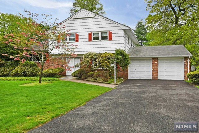 Prime Street in Couontry Club area of desirable Oradell, w/almost 2,200 sq ft of living space plus bsmt, & huge double lot - 100x150 ! Great Sugar Maple Split layout, ready for your interior design updates! Large welcoming double door entry foyer, 1st flr bonus rm could be 4th BR or home office/play rm etc, eat in kitchen w/convenient Laundry Closet. Connected Dining Area overlooked by the huge family rm w/wb fireplace! 3 BRs on top flr w/Master Suite w/large MBR + Master bthrm. Hardwood flrs! Central AC too! Sprinklers (as-is) 200 amp electric, 3 zone heat, & a large 2 car attached garage! All this plus a fabulous large open backyard w/Barbecue patio & gas line grill! All this in a prime street, close to train, shopping, highways & top rated schools! Dont miss this opportunity to get into the prestigious town of Oradell!