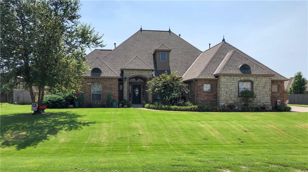 This stunning 4 bedroom model home is only minutes away from Riverwind Casino & Norman! You will fall in LOVE at first sight as you pull around to the 3 vehicle garage with a cellar. Walking through the front door your eyes are drawn across the open floor plan living area to the beautiful gas fireplace centered between two large picture windows with a back yard view! The Master Suite includes back patio & fire pit  access, massive wrap-around walk-in closet, walk-in tile shower with dual shower heads, and a Jetta Whirlpool tub! The kitchen is EVERYTHING with granite counters, water filtration system,& amazing appliances! Take a walk on the WILD side up the Leopard print staircase that leads to the HUGE Theater room with built in Movie Screen! Returning downstairs you can find 3 more bedrooms and 2 more bathrooms! Outside you will find an amazing covered patio with wood burning outside fireplace, 30x30 completely insulated shop, large yard, and brand new privacy fence around it all!