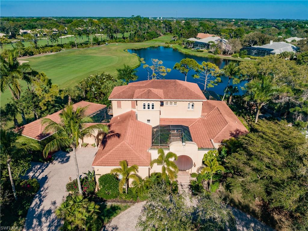 Welcome to BAY CREEK IN PELICAN LANDING! If you are looking for the perfect home to enjoy the best of Florida Lifestyle, you will love this spectacular and unique Custom designed Estate Home with stunning Lake and Golf Course views surrounded by tropical landscaping. The main house of this 12200+ total SF Estate features a large Great Room with Wet Bar * Kitchen with center island, upgraded cabinetry and appliances, a gas Cooktop and GE Advantium double oven, as well as granite counters and large walk-in pantry * Breakfast Nook * 5 Bedrooms plus Den * Exercise Room and Safe Room in Master suite * 5.5 Bathrooms * oversized 3-car Garage with tile floors. The Guest House offers a large Cabana with Murphy Bed * Kitchen * 1 Bath * covered Lanai with amazing views * oversized 1-car Garage. The Estate also offers a beautiful Courtyard Garden * large, covered Lanai with Fireplace and Outdoor Kitchen, Pool & Spa with serene Golf and Lake Views. Bay Creek is a gated neighborhood located within Pelican Landing west of US 41. The amenities include a 34-acre private beach park, sailing club, tennis, bocce, pickleball, canoe & kayak, fitness center and private Golf Club!