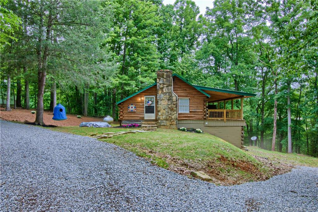 Peaceful Log Cabin with seasonal views, abundant amount of wildlife.  Large covered porch great for entertaining guests.  Has plenty of storage space, and workshop in the basement.  7 minutes from I-26.  New metal roof was put on in 2017, central heating and air installed in 2019.   Property will be sectioned off or option to buy the adjacent cottage (599 Deep Gap Loop)  with property lines as pictured in photos.  Survey will need to be done at time of sale.  The cottage would be great for an investor, and could be used as a guest house or income property.  Log cabin has a shared well and septic with the cottage.  A right of way will be set in place for the cottage unless it is purchased in sale.