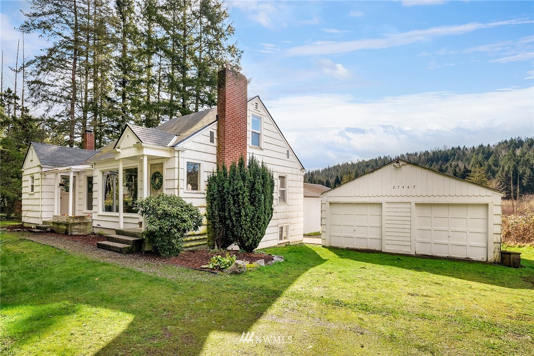 First time on market! Wonderful opportunity to own 1.54 acres w/a charming 1950 farmhouse. Approx 1450 sq ft of living space, (doesn't include 1050 sq ft in unfinished basement), the main level of this sweet home has a spacious, light-filled kitchen, lovely dining rm w/huge view window & custom-built-in cabinet, spacious living rm w/stove/fireplace, beautiful hardwood floors, built-in shelves & enormous view window, a quaint master bedrm w/quiet sitting area, & another full sunny bedroom, & one full bath. The upstairs includes a open loft area, 1/2 bath, & bedroom. The large basement houses the laundry area, furnace, & water filtration system for the well, great space to make your own. 2-car detached garage, firepit, & more! Come on home!