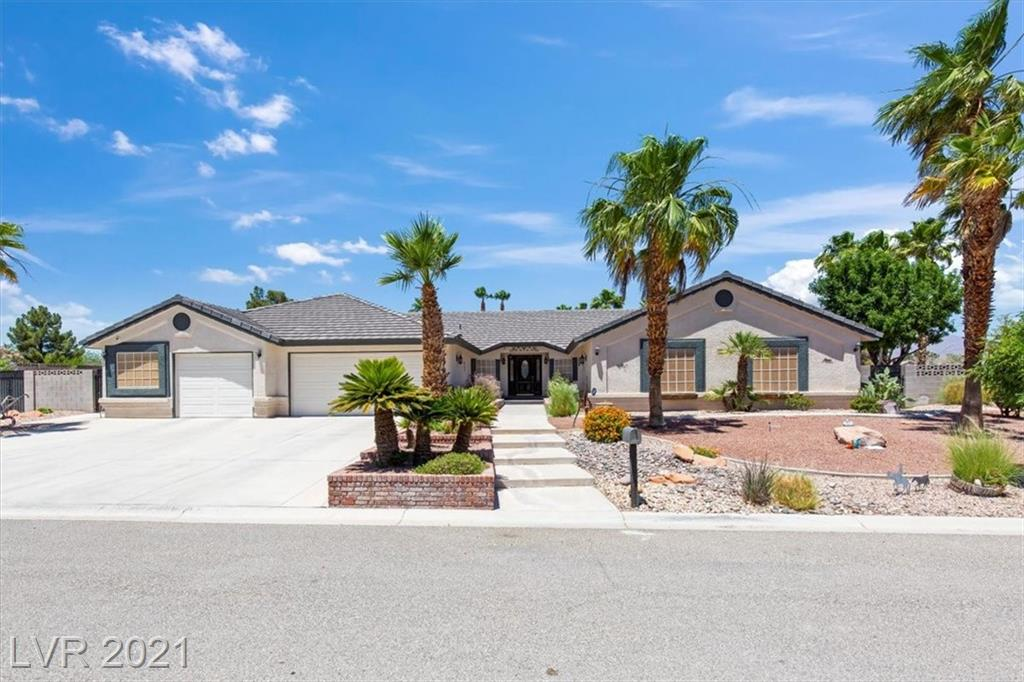 Stunning & Impecabbly Maintained Custom 1-story on a cul-de-sac, 1/2 acre, corner lot & NO HOA! The backyard is a tranquil oasis w/beautiful landscaping, sparkling pool/spa/waterfall heated by solar panels (paid for). Boasting 4 beds (1 bed closet is now a customized office space), 4 baths, RV Access & 3 car garage w/workshop. Vaulted ceilings, picture windows, lots of natural light, massive fireplace w/hearth & mantle & uniquely designed Den w/cove ceiling. Kitchen w/Granite counters, Porcelain tile plank floors, island, brkfast bar & wi/pantry. Butler pantry w/Granite, same floors & blt-in hutch. Adjacent DR area w/same floors & bay window. Primary Bedroom sits apart from secondary bedrooms w/French doors to patio, bay window & sitting area. Primary bath w/his & hers sinks w/Cararra Marble counters, claw foot tub w/Carrara surround, wi/shower w/marbled tile floor & Subway tile accents & wi/closet. Secondary bedrooms w/blt-in window seats & 1 w/3/4 bath, Security cameras w/monitor