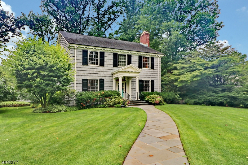 Picturesque setting for meticulously maintained colonial. Gardenlike grounds with  blue stone patio and enclosed sun room ideal for warm weather entertaining.  Full house generator, all new windows,. AKA 21 MOUNTAINVIEW DRIVE Absolute move in condition. Private lane behind home provide access to dway and 2 car garage. Annual association fee $300 for lane maintenance. Gracious proportion, beautiful millwork and lovely hardwood floors. Lower level rec room and laundry room. Newer hw heater. Wave ventilation system. Fireplace in livingroom gas, basement is decorative only,  Chimney in  AS IS  condition. Elegant and bright home on beautifully landscaped grounds. Convenient to downtown Mountainside and to NYC buses.