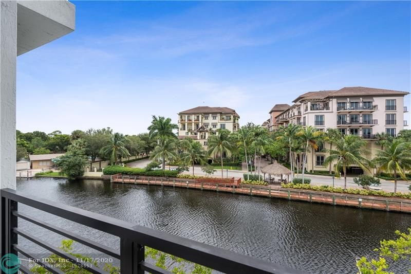 """When only the very best will do! Current owner was one of the first in line to select this prime end unit during pre-construction w/ bright south exposure, serene riverfront view and 5 add'l side windows! This magazine quality residence has been lavished with over $80,000 in quality designer upgrades at every turn. Amazing chefs eat-in kitchen w/ stylish quartz counters, SS GE appliances, gas cooktop & double oven. High-gloss Porcelain floors in 2nd floor """"great"""" room complete w/ 23' waterfront terrace, & 18' impact sliders, contemporary SS  stairway & custom window treatments. Large 1st floor family/media room w/ an additional 23' private waterfront patio. This exclusive, secluded gated riverfront community is just seconds from Wilton Dr. & Oakland Park culinary arts district."""