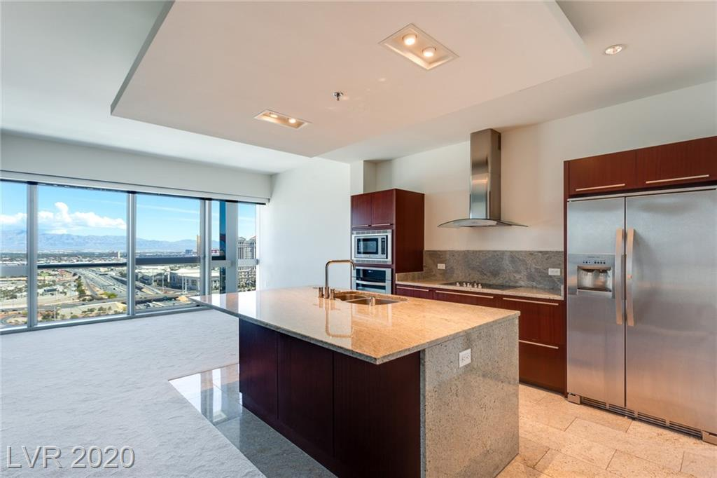 Gorgeous 29th floor end unit condo with fantastic views of the Strip and mountains. Can be combined with the next door unit (also listed) to create a massive single residence. Stainless steel appliances, granite counters, marble and carpet flooring. Beautiful views! Bathroom features a separate tub and marble shower. Long term tenant in place until September 30, 2021 at $2,000 per month