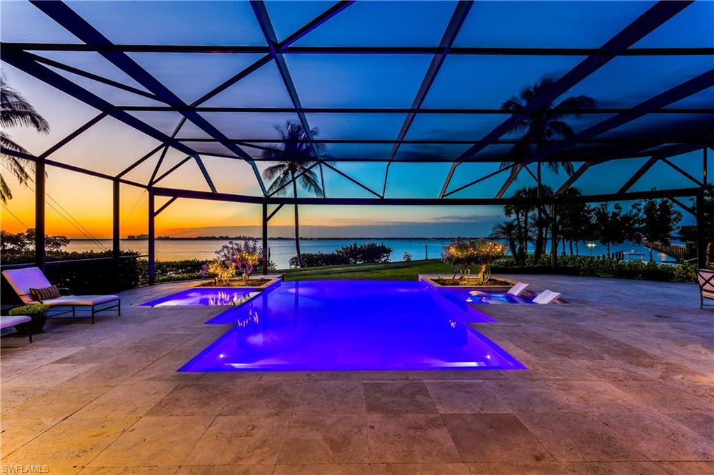 WELCOME TO an INCOMPARABLE Waterfront Luxury Residence w. direct Gulf Access and stunning 190 ft of riverfront frontage on 0.42 acres! This elevated furnished MASTERPIECE features 2,500 sq.ft travertine paved living outdoors & over 3,000 sq. ft indoor living in best & gated location! Enjoy the large infinity edge pool, SPA, outdoor kitchen & your own private riverfront fire pit! The contemporary 4 beds + office home, 3 car garage features luxurious upgrades, impact doors & windows. Beautifully tiled, modern open gourmet kitchen w. granite countertops, stainless steel appliances, beautiful custom made white cabinets & lighting, a huge walk-in pantry - perfect for entertainment! The Master features outstanding water views & sound of the waves! The ensuite boasts a large shower, tub, granite countertops & daylight. Luxurious walk-in closets. 3 guest bedrooms & baths. Separate pool bath w.shower. Whole house generator; 500 gallon propane tank. Freshly painted,roof just cleaned. The WATERFRONT community has a PRIVATE MARINA, DIRECT GULF ACCESS, private pier, 2 community pools, tennis, pickleball & private beach. LOW HOA dues. BEST LOCATION to restaurants, shops, entertainment & beaches!