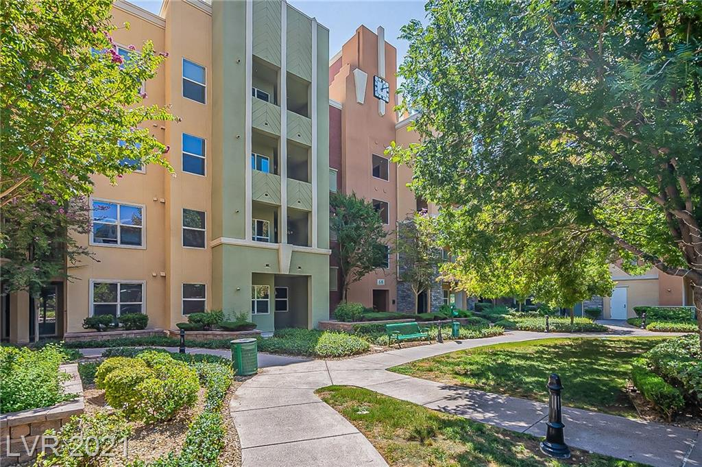 Darling 2-Bedroom Unit in Manhattan with Open Floorplan, Granite Counters in Kitchen with Breakfast Bar - Tile Flooring, Upgraded Baseboards & Pillars top off this Lovely Condo