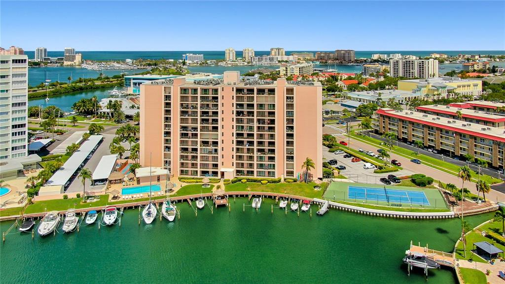 BEST PRICED WATERFRONT CONDOMINIUM IN CLEARWATER BEACH!!! When entering this condominium, the unparalleled views become immediately apparent. This one bedroom one bathroom condominium has a spacious living room, king sized bedroom, walk-in closet, all within an open concept floor-plan. Your oversized private balcony offers panoramic views of the intracoastal, pool area and marina. You will enjoy resort style amenities, living in one of the most desirable waterfront buildings in Island Estates. This secured building offers a keyless entry into the building and a beautifully renovated lobby. While spending time outdoors some of the amenities that can be enjoyed include: Dolphin and manatee viewing, fishing, a marina, oversized heated pool and spa, waterfront tiki tables, tiki bar, his and her restroom facilities equipped with showers and sauna, kayak storage, shuffleboard court, tennis court, and BBQ area. This property is also a short walk to the #1 beach in the US, Pier 60, the best restaurants, Publix, shopping and all that Clearwater Beach has to offer. This unit is currently leased until June 01, 2022, providing income for the new owner. Call today for more details! (THIS WILL NOT LAST LONG!)