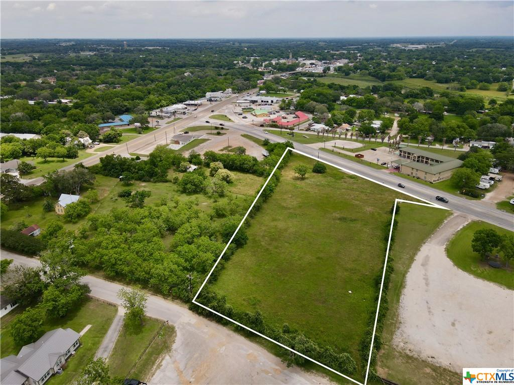 Tract #2- Undeveloped 2.5 acre +/-  tract of land ready for commercial development, in a prime location with excellent exposure near the busy intersection of State Highway 90A & State Highway 77S. State highway frontage on US Hwy 77S and city street frontage on the backside of the tract from Auction Ring Road in Hallettsville, Texas. Several hotels, restaurants, retail businesses & a large venue nearby. Some restrictions apply. Within the city limits and access to all city utilities. Survey needed. Easy access to Interstate 10, Victoria, San Antonio & Houston. An additional 2.5 acre +/- tract is adjacent to the property and also available.