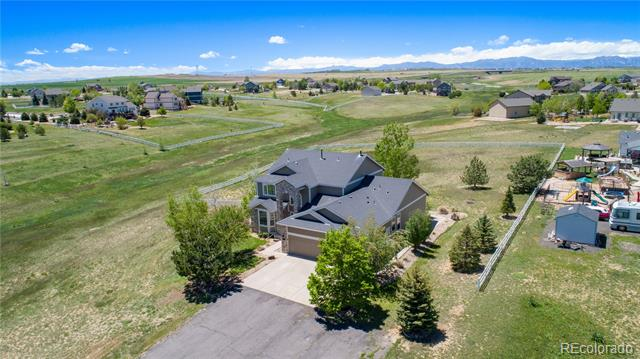 The quiet country setting you've always dreamed of! Tucked away at the end of a private lane, this beautiful home boasts a 2+ acre lot with mountain views and a bright, open floorplan. A 2 story entry leads into the spacious great room with a gas fireplace, built-ins, and expansive windows that showcase stunning views. The large remodeled kitchen features a huge slab granite center island, pantry and access to backyard deck. The luxurious main floor master suite hosts vaulted ceilings, generous sitting area, and 5 piece master bath. Other main floor highlights are a study and formal dining room, both accented with crown molding. The spacious upper level is comprised of a versatile loft, 3 beds, and 2 full baths. The full sized garden-level basement awaits your finish. The huge backyard is the perfect place to relax and soak in the incredible privacy and fabulous mountain views. Todd Creek Vistas is a quiet, peaceful neighborhood with easy access to E-470, DIA, Denver & Boulder.