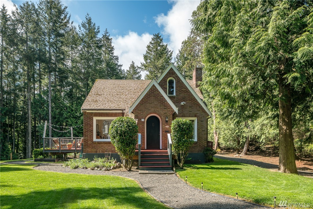 Charming Tudor style home on 2.98 acres near Roche Harbor Resort. 3 bedrooms, 2 baths, with updated marble kitchen counter tops and granite counter tops in bathrooms, built in linen cabinets and drawers. Originally built in 1929, this home has retained the qualities of the era with curved plaster moldings, nook and spacious sunny deck off kitchen. Fenced area for a garden or pet, separate shed ideal for studio and/or storage. Lovely landscaping with privacy and sunshine!