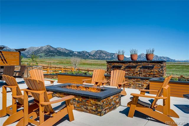 """It's all about the WOW factor with this home!  Stunning Flatiron mtn. views are the back-drop from nearly every room! The open/airy floorplan is an entertainer's dream with its 2-story vaulted great room, adjacent gourmet kitchen, formal dining, study, and main-floor guest bedroom & bath.  Cooking in this dream kitchen is a breeze with its double ovens, gas cooktop w/ss hood, microwave, """"smart"""" refrigerator, apron sink, granite/quartz double islands, walk-in pantry & mudroom! Upstairs features the master bedroom w/5-piece bath (double walk-in closets), a loft, and 3 additional bedrooms each with their own baths!  The backyard is the epitome of """"outdoor living"""" and features a massive patio (partially covered), professional cook-station (grill, 2-burners, sink), 3-spillway waterfall, hot tub, firepit, and multiple rock panting beds all with unprecedented, unobstructed views of open space & the Flatiron mountain range! The 4-car garage is also a car enthusiast's dream!"""
