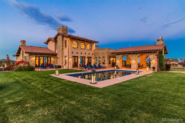 Sensational Tuscan Villa custom masterpiece in idyllic Spruce Meadows. 2.36 acre landscaped estate with resort-style backyard & 2.5K sf of outdoor courtyards, in-ground pool, basketball 1/2 court & outdoor kitchen. Home boasts limestone floors, marble counters & Brazilian cherry wood floors. Gourmet dual island kitchen with imported Cantera stone from Guadalajara & commercial grade appliances. Stunning master suite dual steam shower, his/her closets, fireplace & balcony. Stunning at every turn.